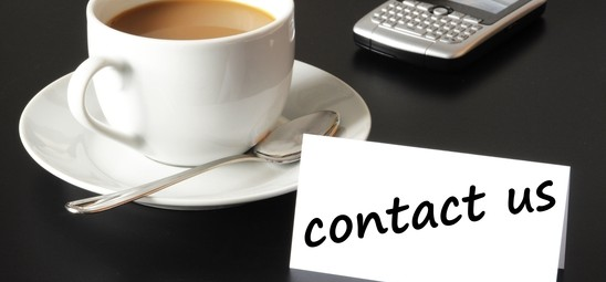 contact us and coffee cup showing business support concept